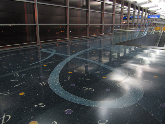 Terrazzo design with 1000 waterjet cut letterforms and handwriting